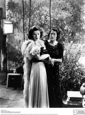 Muriel King designed the costumes for Stage Door and Katharine Hepburn looks beautiful in this flowing dress. She's stealing a scene with veteran actress Constance Collier in this still from the film.