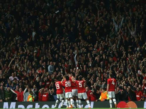 The team celebrate after Vidic's header gives us a 1-0 lead over Bayern