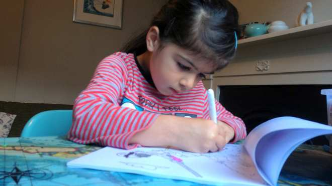 girl-colouring-in-book