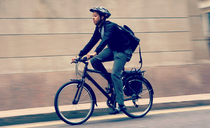 Bloke cycling to work
