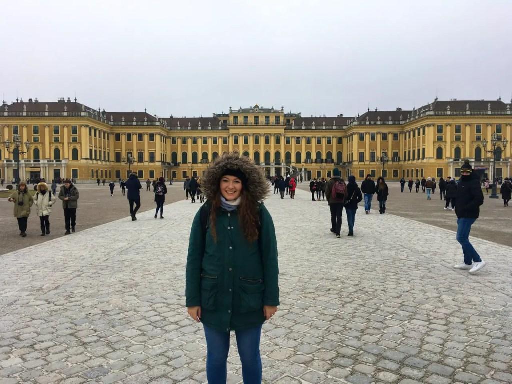 Girl at Schönbrunn Palace in Vienna, Austria in winter.