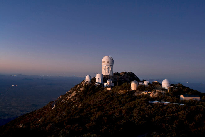 Kitt Peak National Observatory mountain top at Dusk looking north. Visible in the picture are the NOAO 4-meter Mayall, the Steward Observatory 90-inch, the University of Arizona Lunar and Planetary Laboratory Spacewatch Telescopes, LOTIS, 0.4-meter Visitor Center Telescope, Case Western Reserve University Observatory and the SARA Observatory. Credit: P. Marenfeld (NOAO/AURA/NSF)