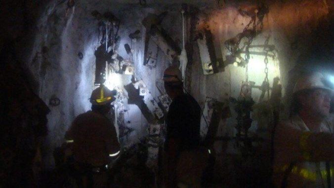Scientists, including Borgonie (right), deep underground at Northam Platinum mine in South Africa. (Marc Kaufman)