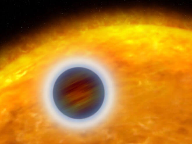 "An artist rendering of a ""hot Jupiter"" extrasolar planet orbiting very close to its host star. The planet designated HD 209458b, is about the size of Jupiter. Unlike Jupiter, the planet is so hot that its atmosphere is ""puffed up."" Starlight is heating the planet's atmosphere, causing hot gas to escape into space, like steam rising from a boiler. (NASA, ESA, and G. Bacon (STScI)."