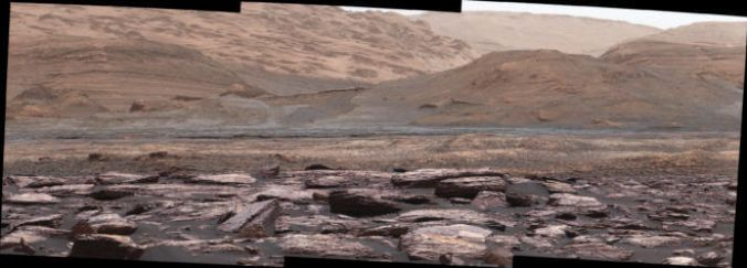 The foreground of this scene from the Mastcam on NASA's Curiosity Mars rover shows purple-hued rocks near the rover's late-2016 location. The middle distance includes future destinations for the rover. Variations in color of the rocks hint at the diversity of their composition on lower Mount Sharp. Credits: NASA/JPL-Caltech/MSSS