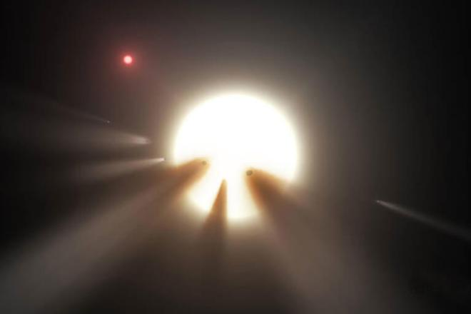"""Artist rendering of star xxx, and the unexplain ed objects close to it. KNown as """"Tabby's"""" star"""
