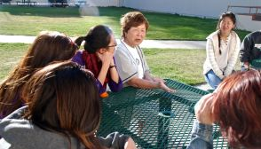 One of the small group discussions during the 2015 Manzanar At Dusk program. That's Nancy Oda, center.