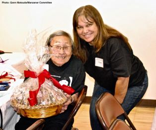 Misao Chomori (left) with her second raffle prize of the day, shown here with Vicky Perez