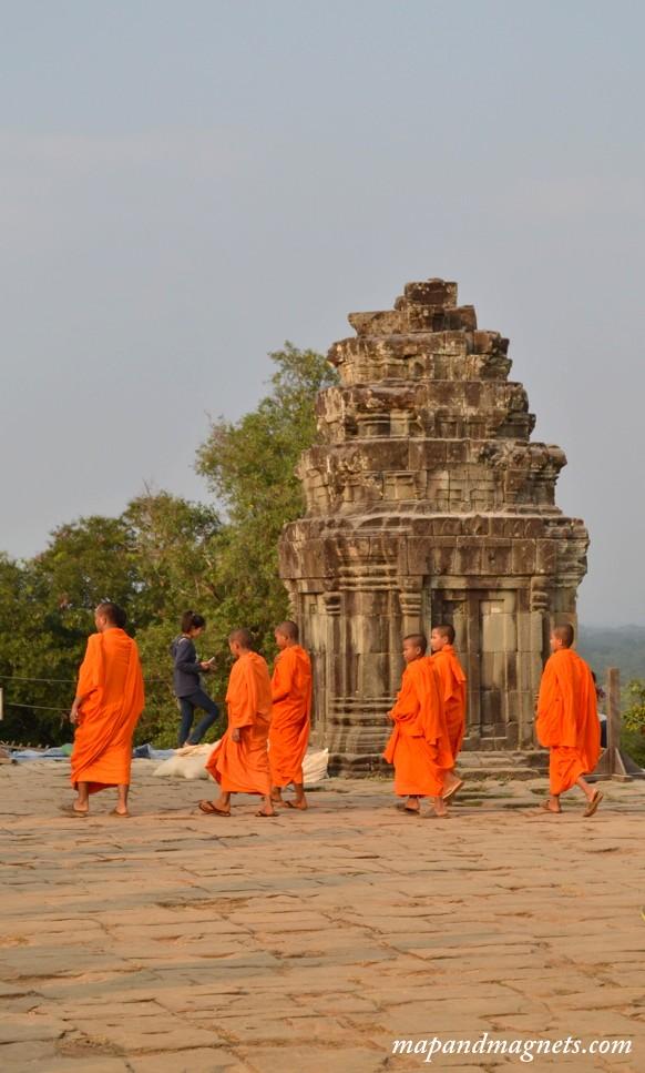 Monks at sunset at Phnom Bakheng