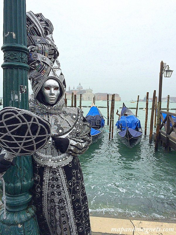 Venice carnival masked man gondola