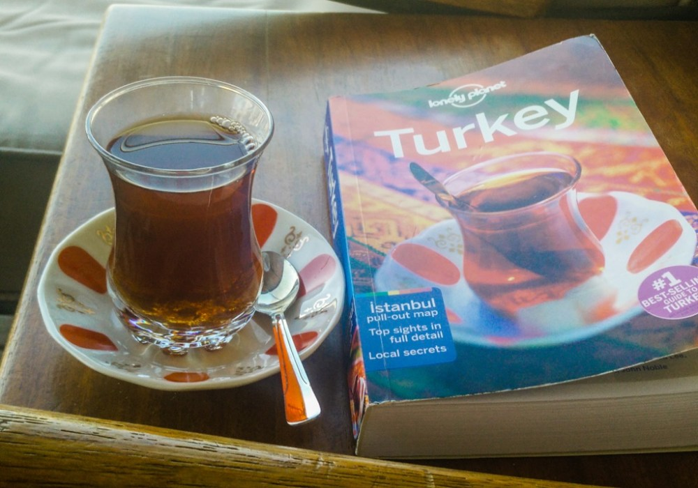Turkish tea and guidebook in Turkey