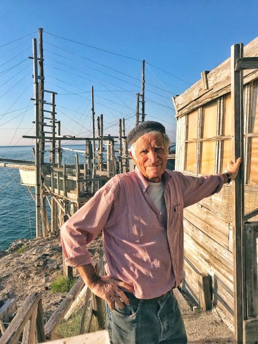 An old Italian man working a fishing boat