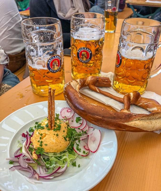 Beer, pretzels and obatdza in an Oktoberfest tent