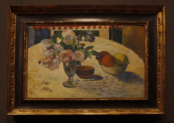 Flowers and a Bowl of Fruit on a Table (1894) by Paul Gauguin