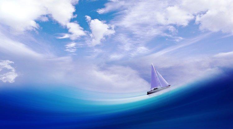 Bateau sur une grande vague bleue