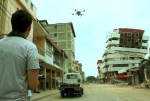 Post disaster relief worker using drones to get an overview map of a disaster area using mapgage