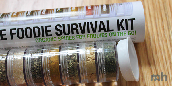 The cannister aligned with the spice pots and lid; there is some empty space in between.