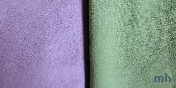 The PackTowl in plum and the REI in green.