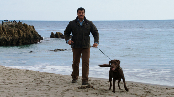 "COSMOS: A SPACETIME ODYSSEY: Host Neil deGrasse Tyson takes a dog for a walk at Drew Point, AK, to illustrate the difference between weather and climate in the all-new ""The World Set Free"" episode of COSMOS: A SPACETIME ODYSSEY"