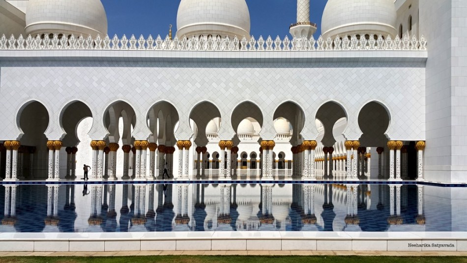 Arches mirrored in the pools around the mosque
