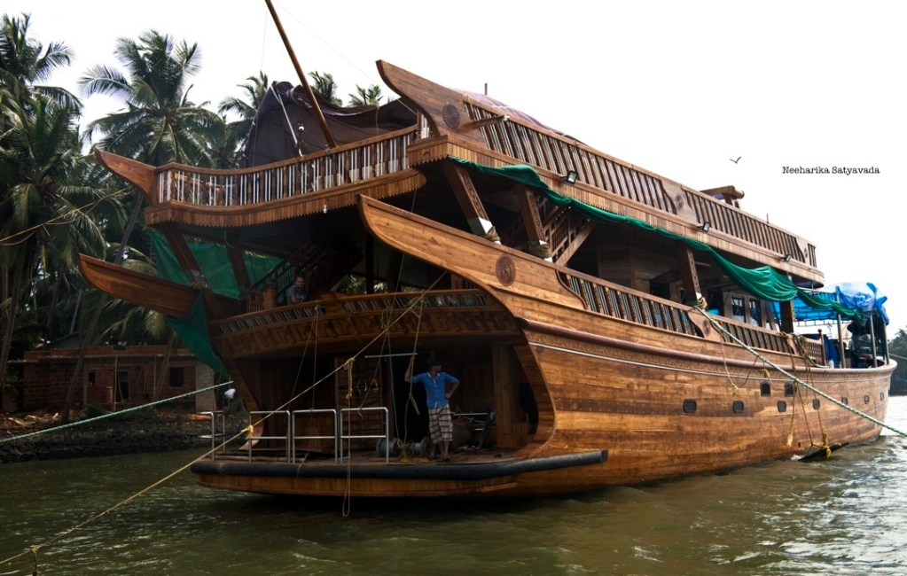 An under construction stands docked on the waters in Beypore, Kerala as the craftsmen take a break.