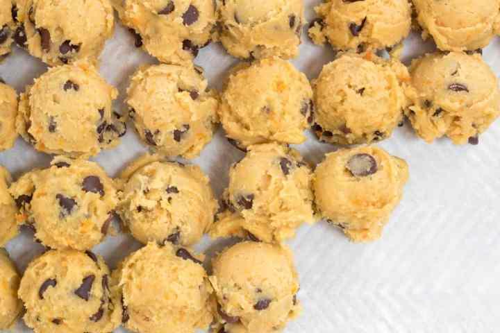 orange chocolate chip cookie dough on sheet pan