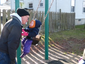 Theresa and Grampy have fun on the swings at Flax Pond playground