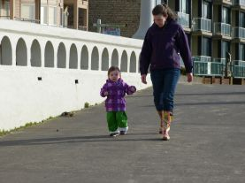 Walking to the beach with Mommy