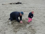 Helping Grandpa with the sand castle