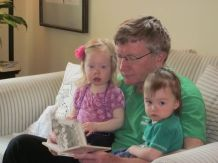 Grampy reads with the girls.
