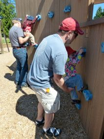 TK gets a boost from Grampy, and Audrey gets a boost from Daddy on the rock-climbing wall.
