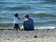 Father and son, contemplating the ocean. And throwing rocks.