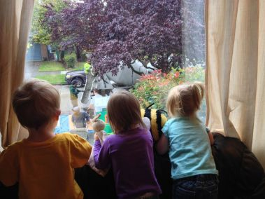 Watching the cement mixer pour cement for our basement.