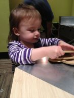 Audrey makes sandwiches at the Children's Museum.