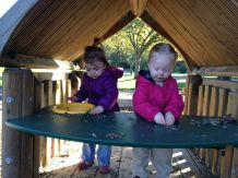 """Audrey and Theresa make """"salmon"""" and """"soup"""" in their kitchen at the park."""