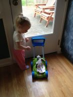 """Theresa puts her bunny in the """"stroller."""""""