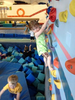 Climbing wall on her own