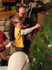 Helping Daddy decorate the tree.