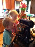 Helping make birthday cupcakes