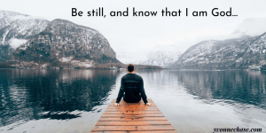 Man sitting on a dock looking out on calm waters. Be still and know that I am God. Psalm 46:10