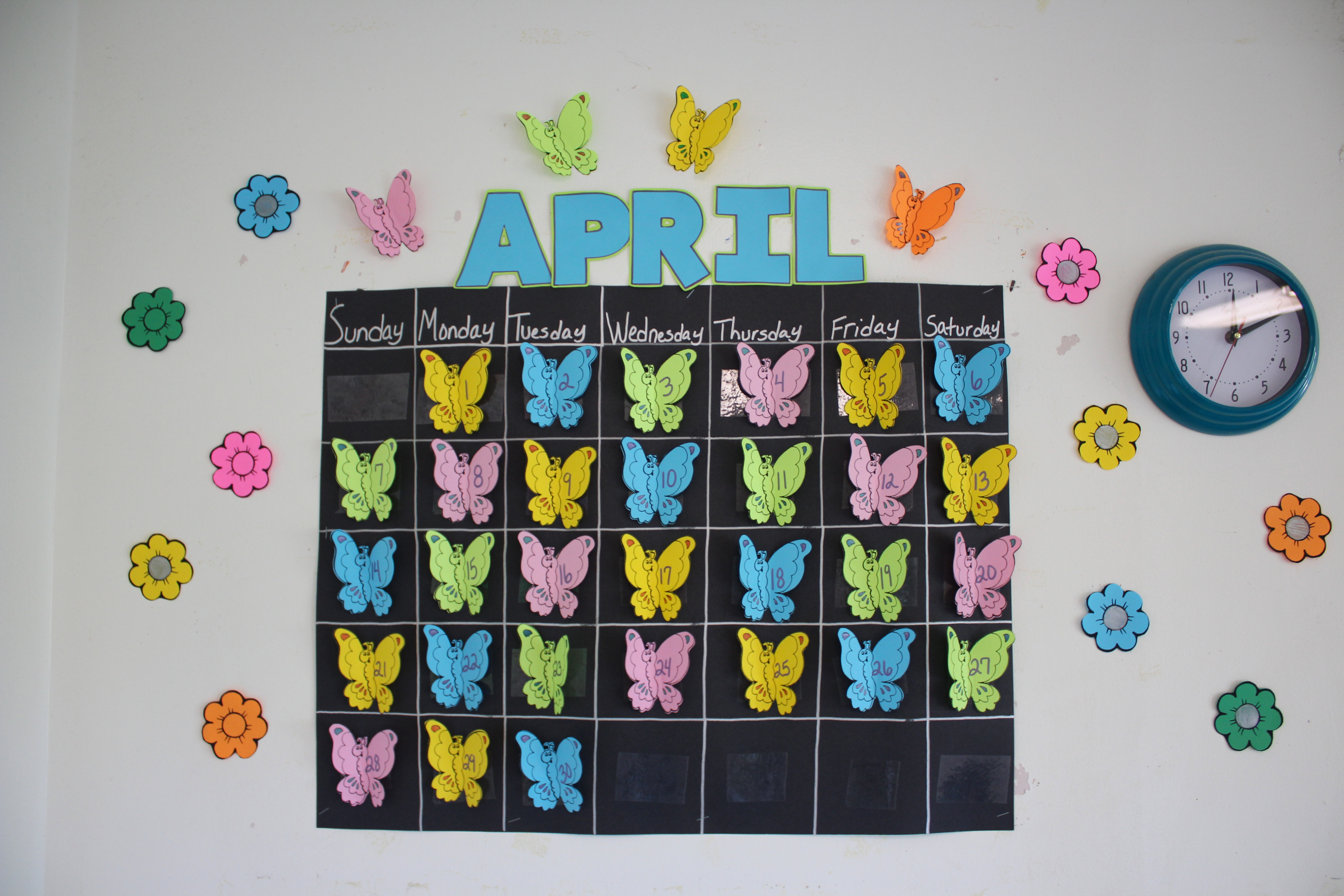 a calendar with butterflies showing every day in the month of April