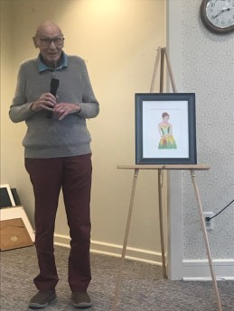 Maplewood Senior Living resident, Dennis showing off his painting of a ballerina