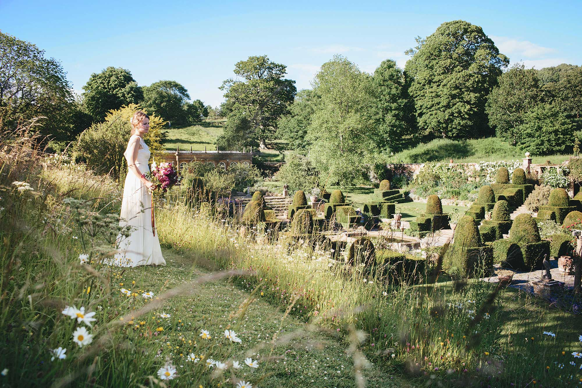 Bride overlooking Mapperton Gardens - Dorset wedding venue