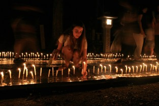 Laura helping to nail candles through the path