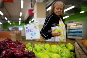 Woman shopping at Daily Table - from RadioBoston article