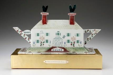 "Mara Superior, ""No Place Like Home"", 2005, 13 x 19 x 10"", high-fired porcelain, ceramic oxides, underglaze, glaze, gold leaf, bone, ink, brass pins."