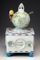 "Mara Superior, ""Smart Planet: Homage to Science"", 2009, 20 x 10.5 x 10.5"", high-fired porcelain, ceramic oxides, underglaze, glaze, wood, gold leaf, tin pencil-sharpener (feet). Renwick Gallery, Smithsonian American Museum of Art (2019.7.2)."