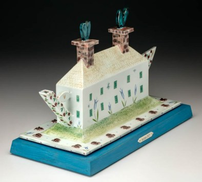 "Mara Superior, ""Harmony Two Chimney House Teapot"", 2010, 11 x 16 x 8"", high-fired porcelain, ceramic oxides, underglaze, glaze, wood, bone, ink, brass pins, milk paint base."