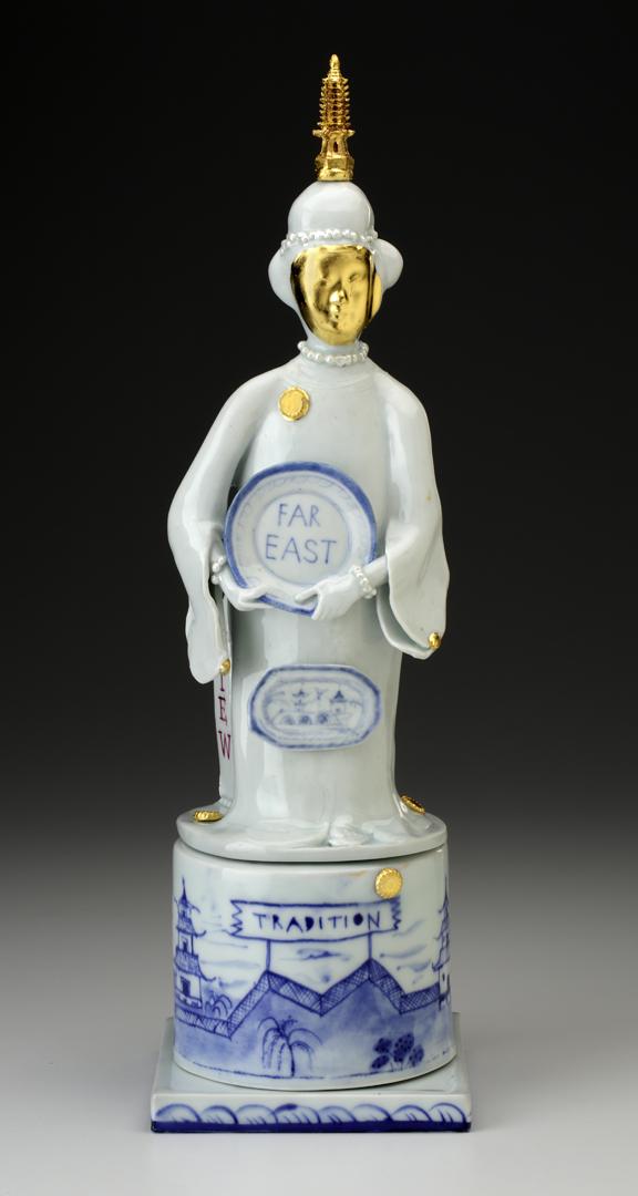 """Mara Superior, """"Far Eastern Goddess No.1"""", 2016, 16 x 5 x 5"""", porcelain, cobalt blue under-glaze, over-glaze enamel, gold leaf, wooden found object."""