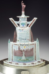 "Mara Superior, ""My New York"", 2004, 18 x 15 x 9"", high-fired porcelain, ceramic oxides, underglaze, glaze, white gold leaf, bone, ink, brass pins.Currier Museum of Art (2019.9a-c)."